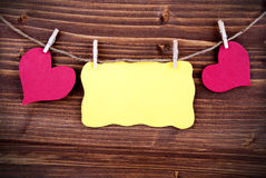 Yellow Label With Copy Space And Two Hearts And Frame Royalty Free Stock Photo