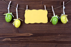 Yellow Label With Four Easter Eggs And Copy Space stock image
