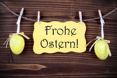 Yellow Label With Two Easter Eggs And Frohe Ostern stock image