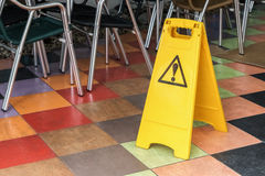 Yellow label warning of slippery floor Royalty Free Stock Image