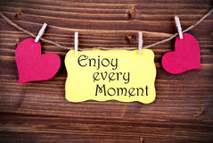 Yellow Lable Saying Enjoy Every Moment Stock Photography
