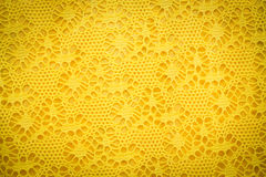 Yellow lace fabric background texture. Royalty Free Stock Photos