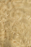 Yellow lacy background. Vintage yellow lacy veil closeup as a background stock photo