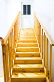 Yellow ladder. Close-up of yellow ladder going upstairs to the room which is closed. Stairway to heaven Royalty Free Stock Photo