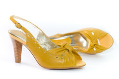 Yellow lady's shoes. Stock Photos