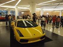 Yellow Lamborghini on display in Bangkok. BANGKOK, THAILAND - JANUARY 8: Yellow Lamborghini inside the Siam Paragon shopping center at the grand opening Stock Image