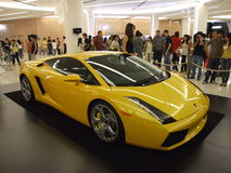 Yellow Lamborghini on display in Bangkok. BANGKOK, THAILAND - JANUARY 8: Yellow Lamborghini inside the Siam Paragon shopping center at the grand opening Royalty Free Stock Photography