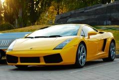 Yellow Lamborghini on exhibition parking royalty free stock photography