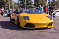 Yellow Lamborghini on exhibition parking at an annual event Supe Stock Photo
