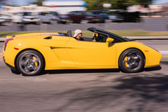 Yellow Lamborghini in the street Stock Photo