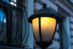 Yellow lamp in the blue street Stock Photo