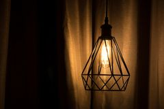Yellow lamp hanging with curtain. Background Royalty Free Stock Photos