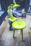 Yellow lamp and little table Stock Photography