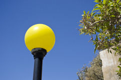 Yellow lampost in a street Royalty Free Stock Photos