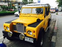 Yellow Land Rover Stock Image