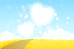 Yellow Landscape with Heart Shape Clouds Royalty Free Stock Photo