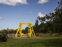 Yellow lawn swing royalty free stock photo