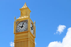 Yellow layout of Big Ben tower on blue sky background. On sunny day closeup Royalty Free Stock Images