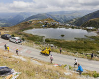 The Yellow LCL Bike - Tour de France 2015. Col de la Croix de Fer, France - 25 July 2015:The yellow LCL bike passing before the peloton on the road to the Col de Stock Images