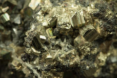 Yellow lead zinc ore. Closeup macro picture of yellow and black lead zinc iron ore with irregular texture Royalty Free Stock Photo
