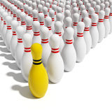 Yellow leader. Bowling pins on white background Stock Images