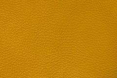 Yellow leather background Stock Photos