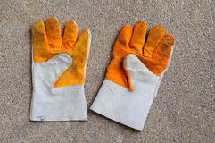 Yellow leather gloves Stock Photography