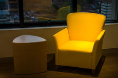 Yellow leather sofa and side wooden table Stock Images