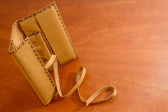 Yellow Leather Tobacco Pouch. Made of natural leather for storage of tabacco bags Royalty Free Stock Photos