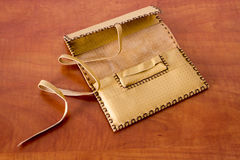 Yellow Leather Tobacco Pouch. Made of natural leather for storage of tabacco bags Royalty Free Stock Photo