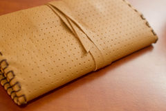 Yellow Leather Tobacco Pouch. Made of natural leather for storage of tabacco bags Stock Photos