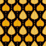 Yellow leaves pattern on dark background. Bright autumn seamless Royalty Free Stock Photos