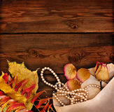 Yellow  leaves on a wooden background Stock Photo