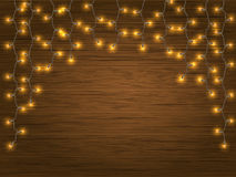Yellow LED Light Christmas Garland. Yellow LED Light Glowing Christmas Garland on wooden background. Vector detailed element to decorate the facade or the wall Stock Images