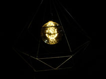 Yellow led light hanging in the dark. With black background Royalty Free Stock Images