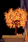 Yellow LED Tree with Dark sky background. Concept of energy saving, cool lighting and decoration Stock Photography