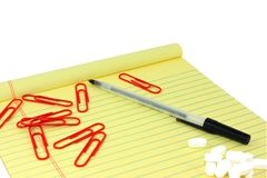 Yellow Legal Pad With Paperclips, Pen, And White P Stock Photos