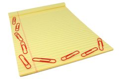 Yellow Legal Pad With Red Paper Clips Stock Image