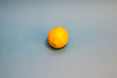 Yellow lemon against a blue background. A yellow lemon against a blue background Royalty Free Stock Images
