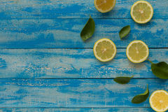 Yellow lemon on a blue wooden background. Top view Royalty Free Stock Image
