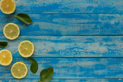 Yellow lemon on a blue wooden background. Top view Royalty Free Stock Images
