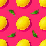 Yellow lemon fruits with green leaves isolated on pink background. Watercolor drawing seamless pattern for design.  stock illustration
