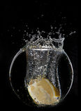 Yellow lemon half in water splash Stock Photography