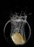 Yellow lemon half in water splash Stock Photography