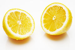 Yellow lemon halves on a white background. A small mirror and shade under theme Stock Photo