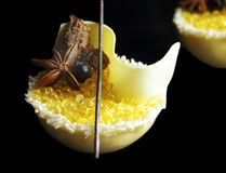 Yellow lemon jelly caviar and white melon mousse dessert with coconut, honey, white chocolate and star anise isolated on royalty free stock photos