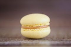Yellow lemon macaron. Yellow french  macaron with lemon curd Royalty Free Stock Photo