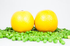 Yellow Lemon and Peas Royalty Free Stock Photography