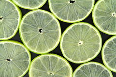 Lime slices on black background Royalty Free Stock Photos