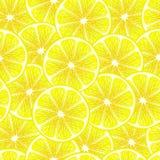 Yellow lemon slices seamless background. Royalty Free Stock Photos